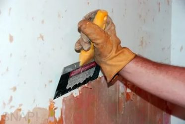 Чем убрать шпаклевку со стены?